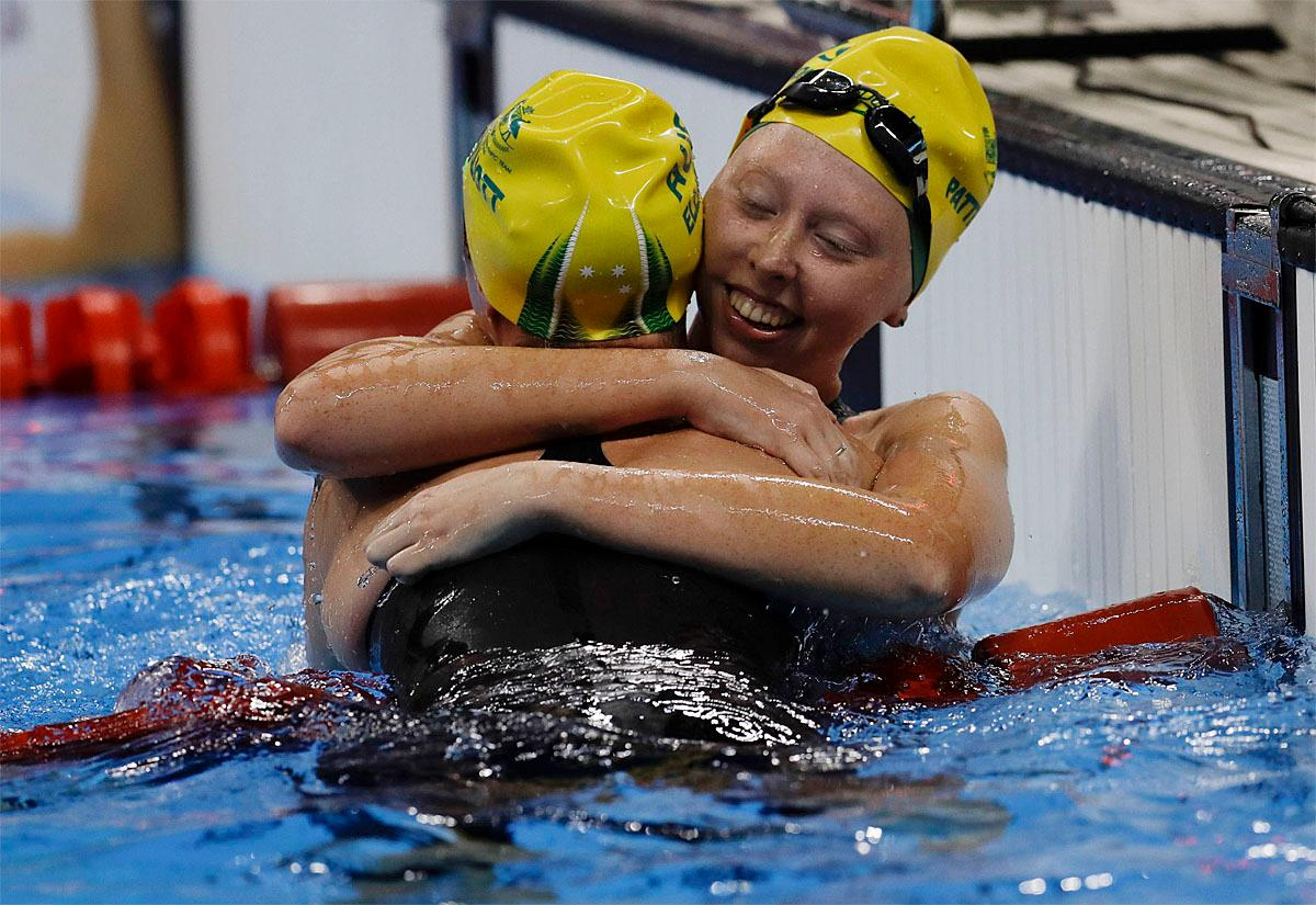 Lakeisha Patterson from Australia, right, embraces her countrywoman Maddison Elliott after Patterson won the women's 400-meter freestyle S8 final swimming event at the Paralympic Games in Rio de Janeiro, Brazil, Thursday Sept. 8, 2016. (AP Photo/Leo Correa)