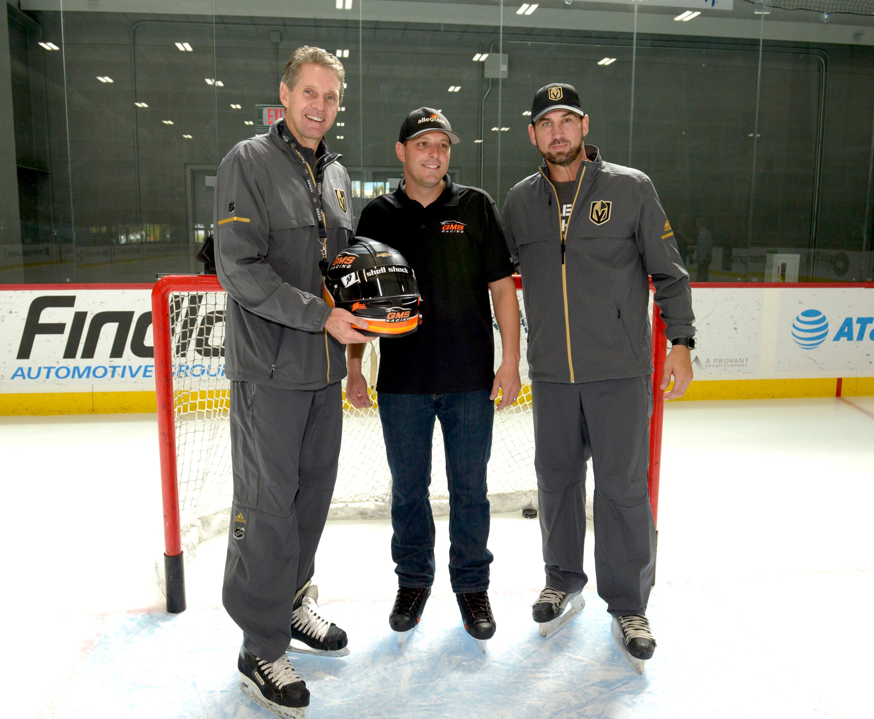 Johnny Sauter (ctr) NASCAR Camping World Truck Series Champion presents his winning helmet to Murray Craven (l), retired hockey professional for the Las Vegas Golden Knights Hockey Team during a hockey skills clinic led by retired hockey professional and Golden Knights TV Analyst Shane Hnidy (r) at City National Arena in Las Vegas. Friday, September 29, 2017. CREDIT: Glenn Pinkerton/Las Vegas News Bureau