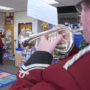 Nebraska Brass Band plays Christmas jingles for students