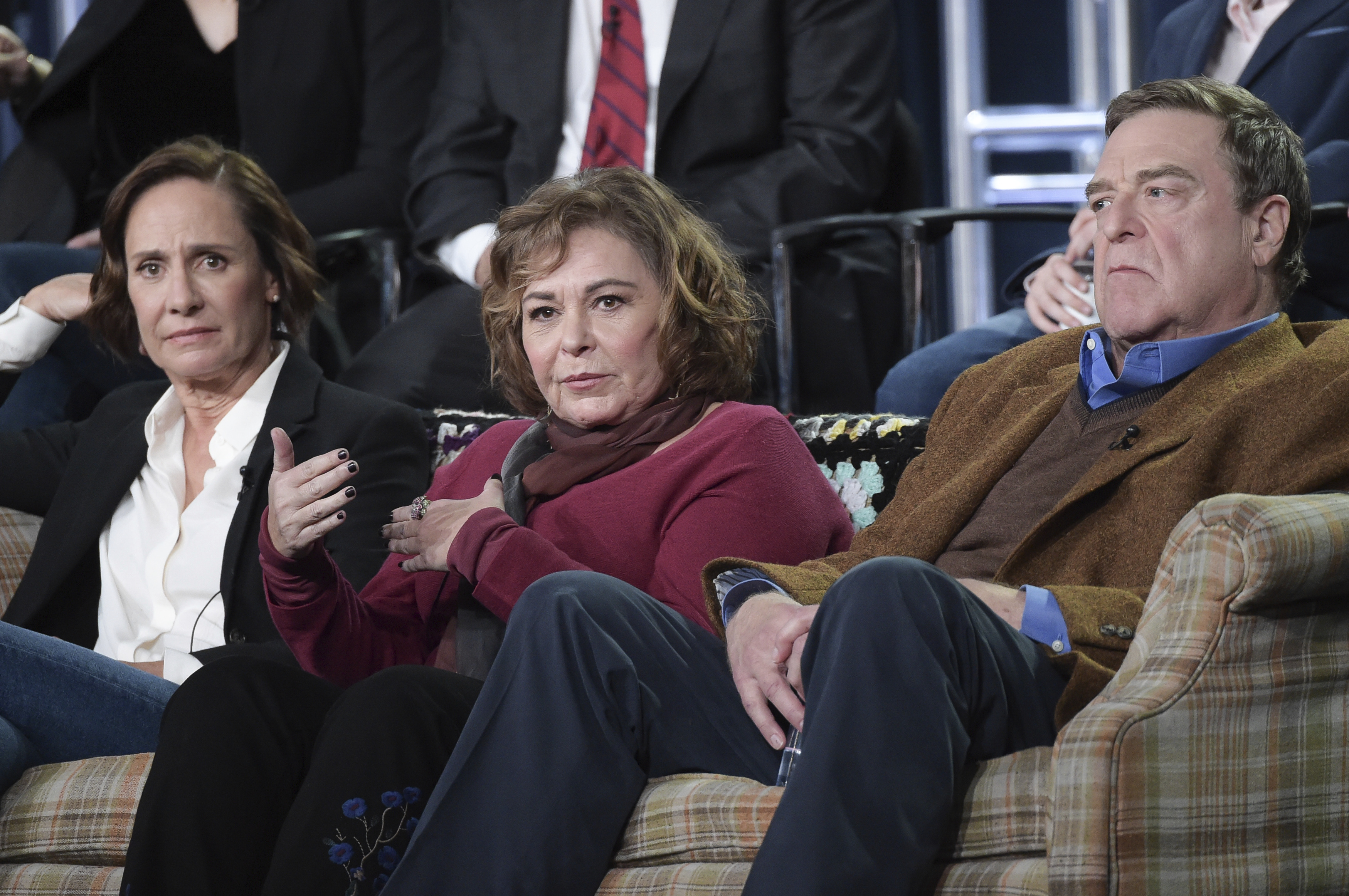 "FILE - In this Jan. 8, 2018 file photo, Laurie Metcalf, from left, Roseanne Barr and John Goodman participate in the ""Roseanne"" panel during the Disney/ABC Television Critics Association Winter Press Tour in Pasadena, Calif. The unprecedented sudden cancellation of TV's top comedy has left a wave of unemployment and uncertainty in its wake. Barr's racist tweet and the almost immediate axing of her show put hundreds of people out of work. (Photo by Richard Shotwell/Invision/AP, File)"