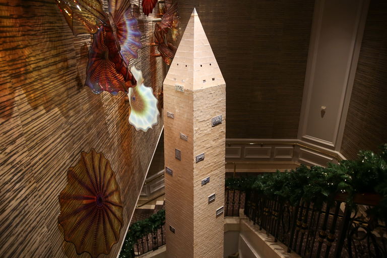 It took 1,000 hours of planning, three weeks of construction, 26 people, 900 pounds of icing, 600 pounds of white gingerbread sugar dough and 251 layers of stacked gingerbread stones for the Ritz-Carlton pastry team to make a 30-foot gingerbread replica of the Washington Monument. (Image: Amanda Andrade-Rhoades/ DC Refined)