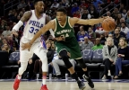 Milwaukee Bucks' Giannis Antetokounmpo, right, dribbles past Philadelphia 76ers' Robert Covington during the first half of a game, Monday, March 6, 2017, in Philadelphia.