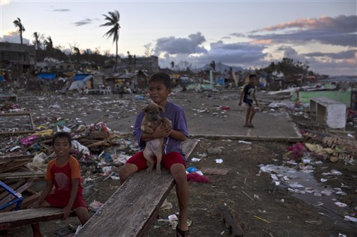 Children who survived Typhoon Haiyan play on a destroyed playground in Tacloban, Philippines.