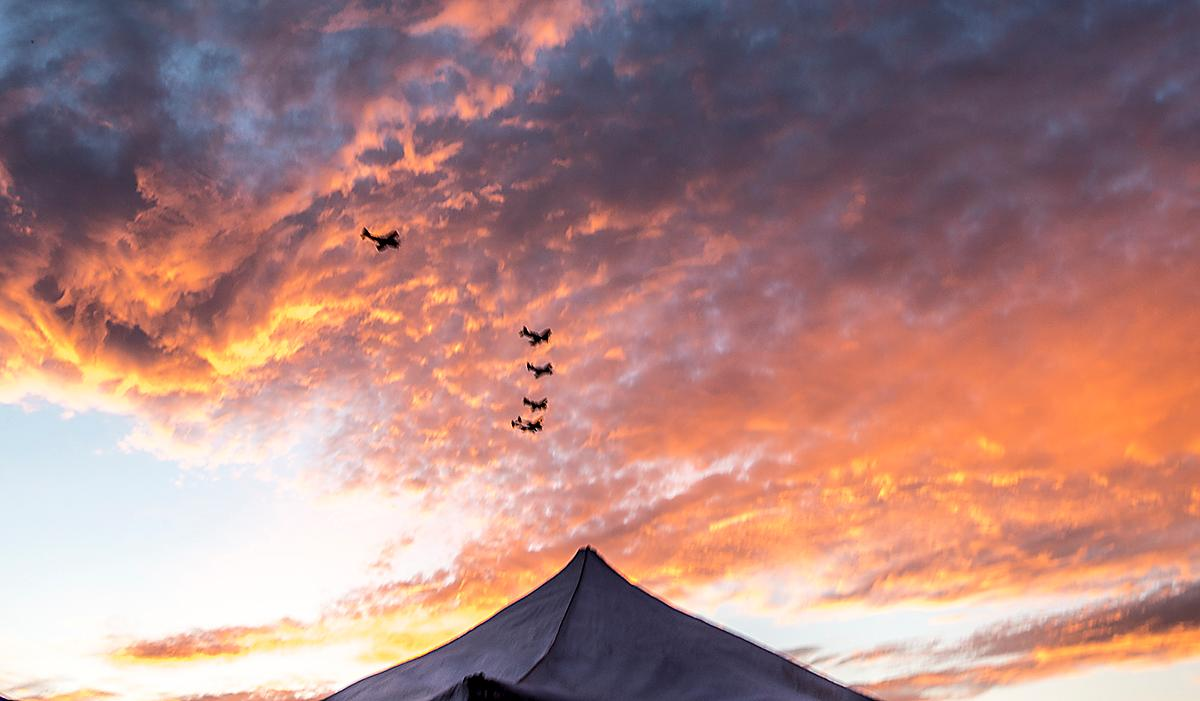 WWII vintage aircraft fly in formation over the Madras airport at sunset on Sunday. Photo by Cheyenne Thorpe, Oregon News Lab