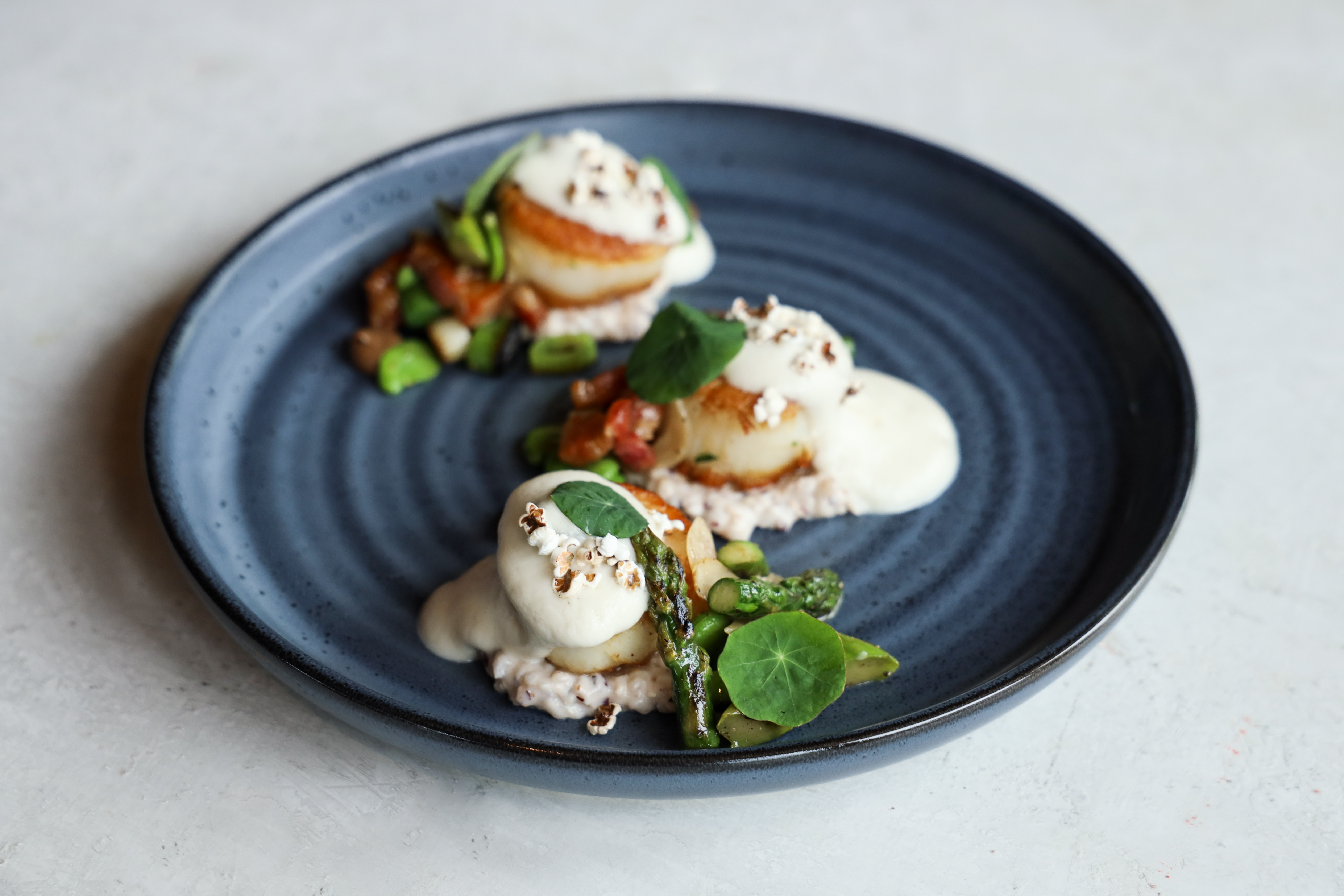 Scallops & Grits:{ }jimmy red corn grits, bacon & cauliflower foam, vegetable hash  (Image: Jennifer Chase)