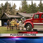 Crews battle structure fire off Willamette Highway in Pleasant Hill