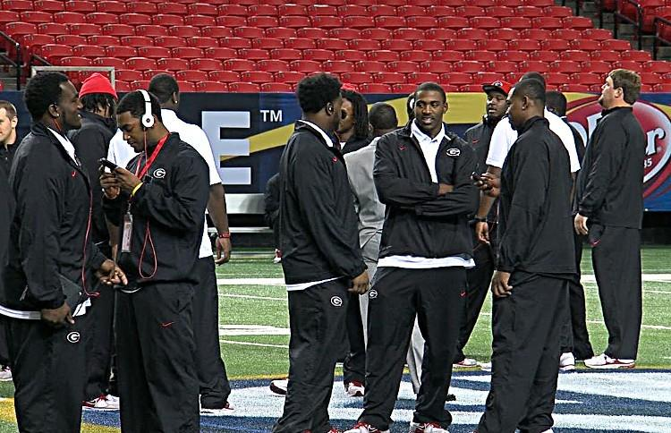 Georgia players stand around at midfield during a walk through at the Georgia Dome on Friday.