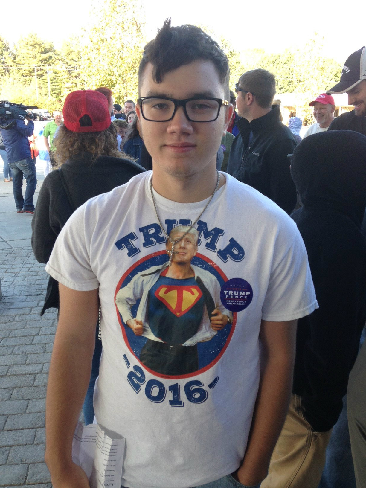 A Trump supporter shows off his shirt. (Photo credit: WLOS staff)