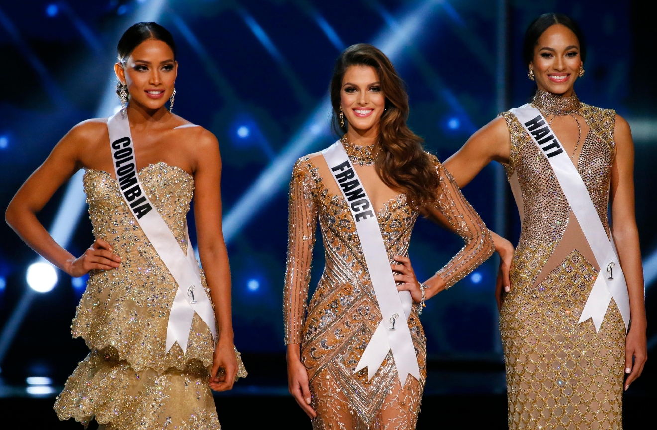 Andrea Tovar of Colombia, left, Iris Mittenaere of France, center, and Raquel Pelissier of Haiti, pose shortly after being declared the top three finalists in the Miss Universe 2016 coronation Monday, Jan. 30, 2017, at the Mall of Asia in suburban Pasay city, south of Manila, Philippines. Iris Mittenaere was crowned the Miss Universe 2016 while Raquel Pelissier was the runner-up. (AP Photo/Bullit Marquez)