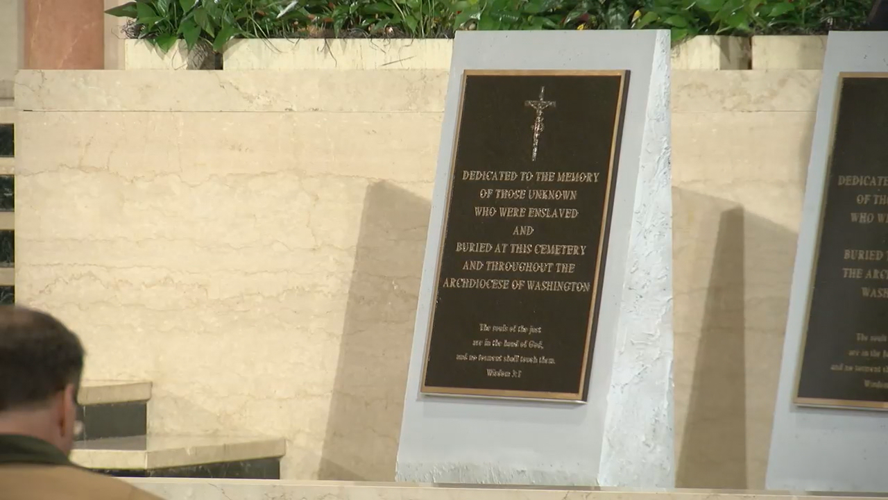 "The stone markers are around four feet tall and have written on them, ""Dedicated to the memory of those unknown who were enslaved and buried throughout the Archdiocese of Washington."" (ABC7)"