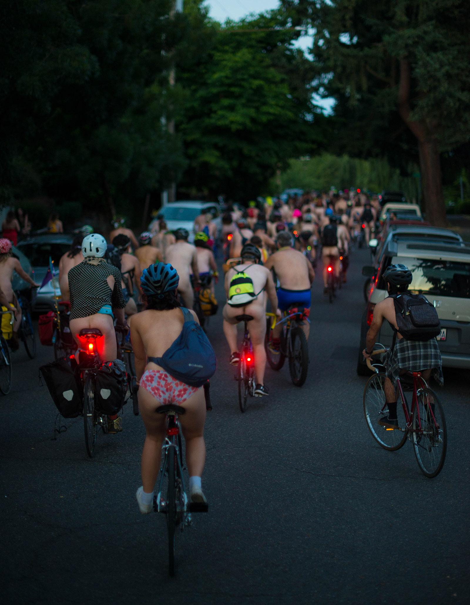 Bare bicyclists filled the streets of Portland on Saturday for the annual World Naked Bike Ride. The ride highlights the vulnerability of cyclists on the roads and global oil dependency, while also promoting body-positive messages. The group gathered in Cathedral Park before riding through the streets. (KATU photo taken 6-23-2018 by Tristan Fortsch)