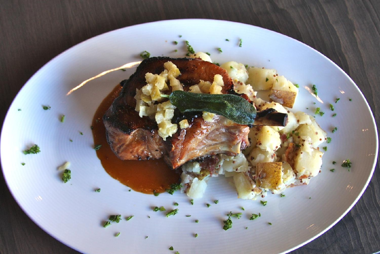 Berkshire Grilled Pork Chop: maple apple cider brine marinade, apple Calvados sauce, and warm roasted German potato salad / Image: Molly Paz // Published: 3.25.17