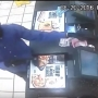 Police release surveillance video of man robbing Taco John's