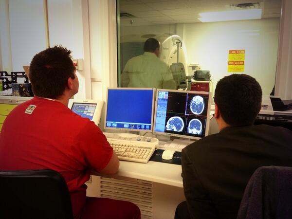 Employees test CT equipment at Moore Med Center, most of the equipment was replaced after the tornado.