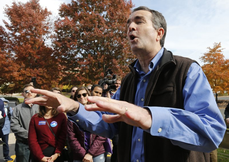 Democratic gubernatorial candidate Lt. Gov. Ralph Northam talks with volunteers at a canvass kickoff site in Sterling, Va., Saturday, Nov. 4, 2017. Northam faces Republican challenger Ed Gillespie in the Nov. 7th election (AP Photo/Steve Helber)<p></p>