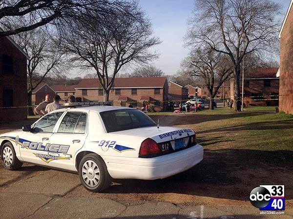 Birmingham police investigate a fatal shooting at a housing complex in Gate City, Ala., Friday, March 21, 2014.