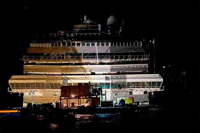 The Costa Concordia is seen after it was lifted upright, on the Tuscan Island of Giglio, Italy, early Tuesday morning, Sept. 17, 2013.