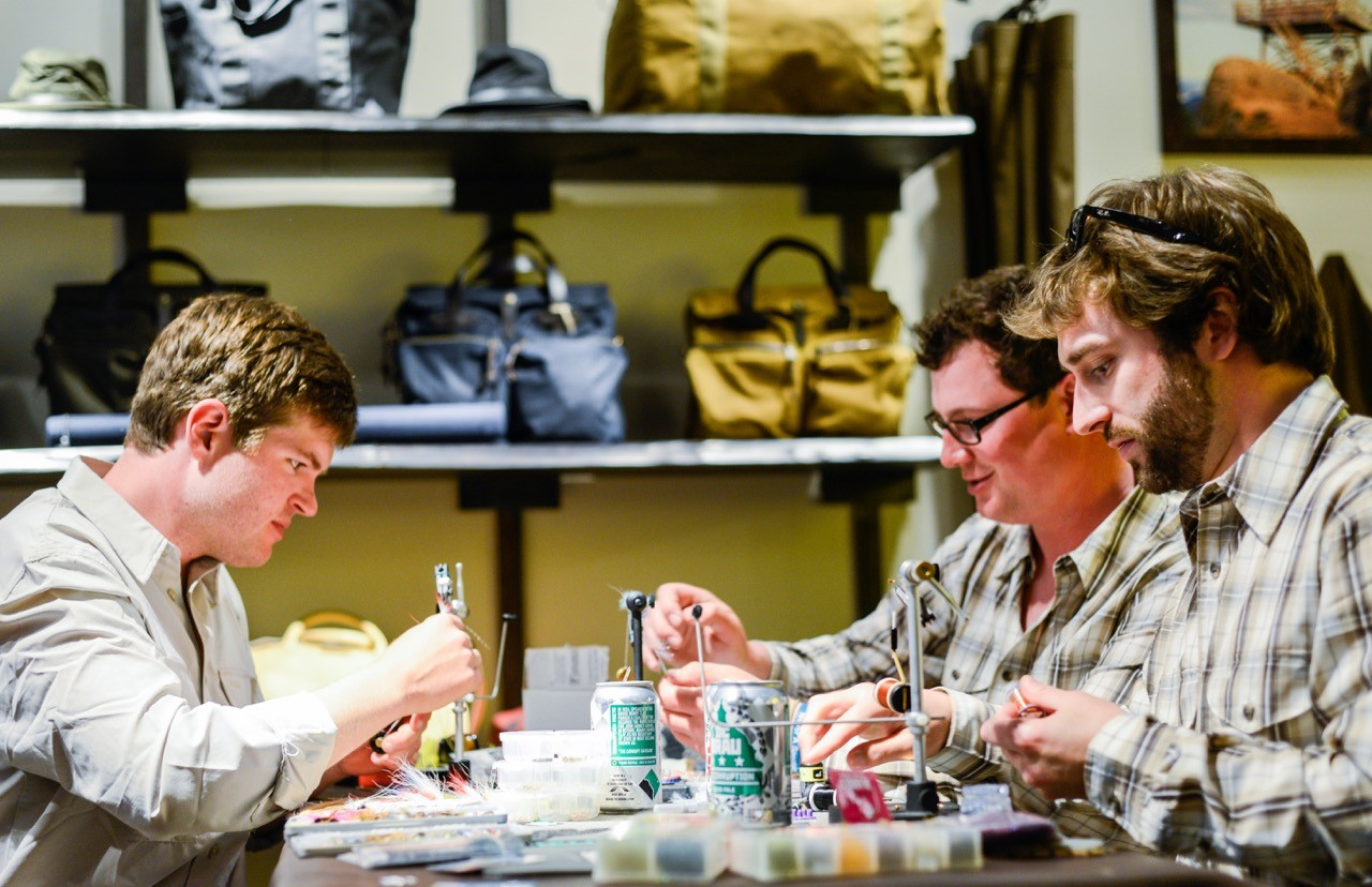 The FlyGuys Connor Donovan, left, Kevin Huntington and Remick Smothers will be onsite at FilsonDC from Noon to 5pm to lead fly-tying demos this Saturday, April 22. (Mokimedia)