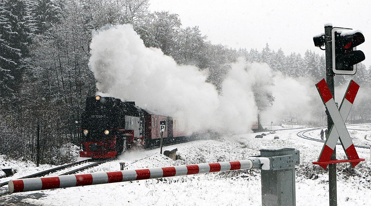A narrow-gauge railway makes its way through a snow covered landscape in Schierke, Germany, Tuesday, Nov. 8, 2016. (Matthias Bein/dpa via AP)