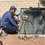 Service technicians try to stay cool while working outside in the heat