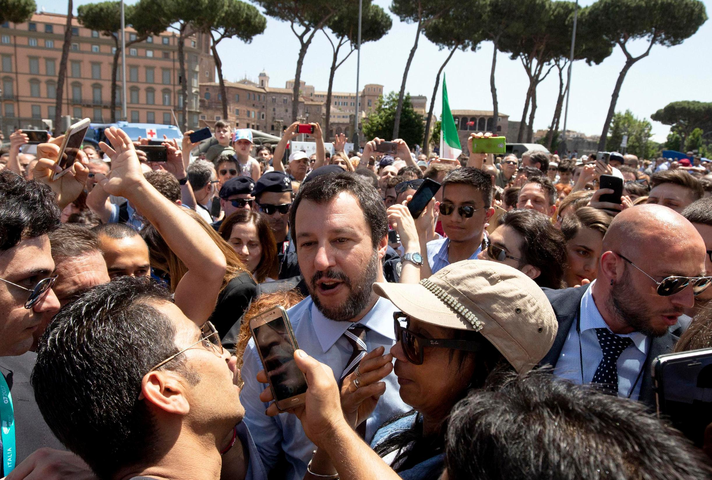 Leader of the League party and Italian Interior Minister, Matteo Salvini, walks through the crowd on the occasion of celebrations for Italy's Republic Day, in Rome Saturday, June 2, 2018.{ } (Claudio Peri/ANSA via AP)