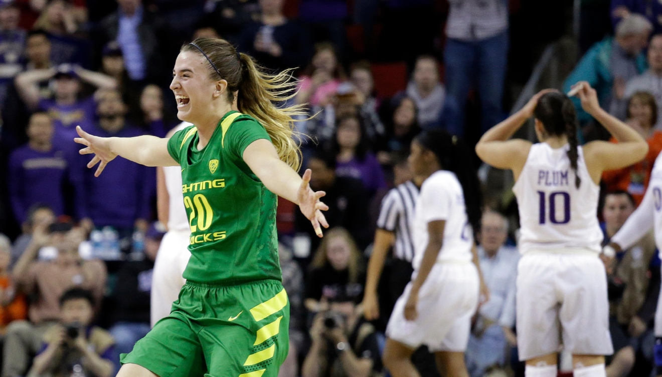 Oregon's Sabrina Ionescu smiles as her team defeats Washington 70-69 in an NCAA college basketball game in the Pac-12 tournament, Friday, March 3, 2017, in Seattle. (AP Photo/Elaine Thompson)
