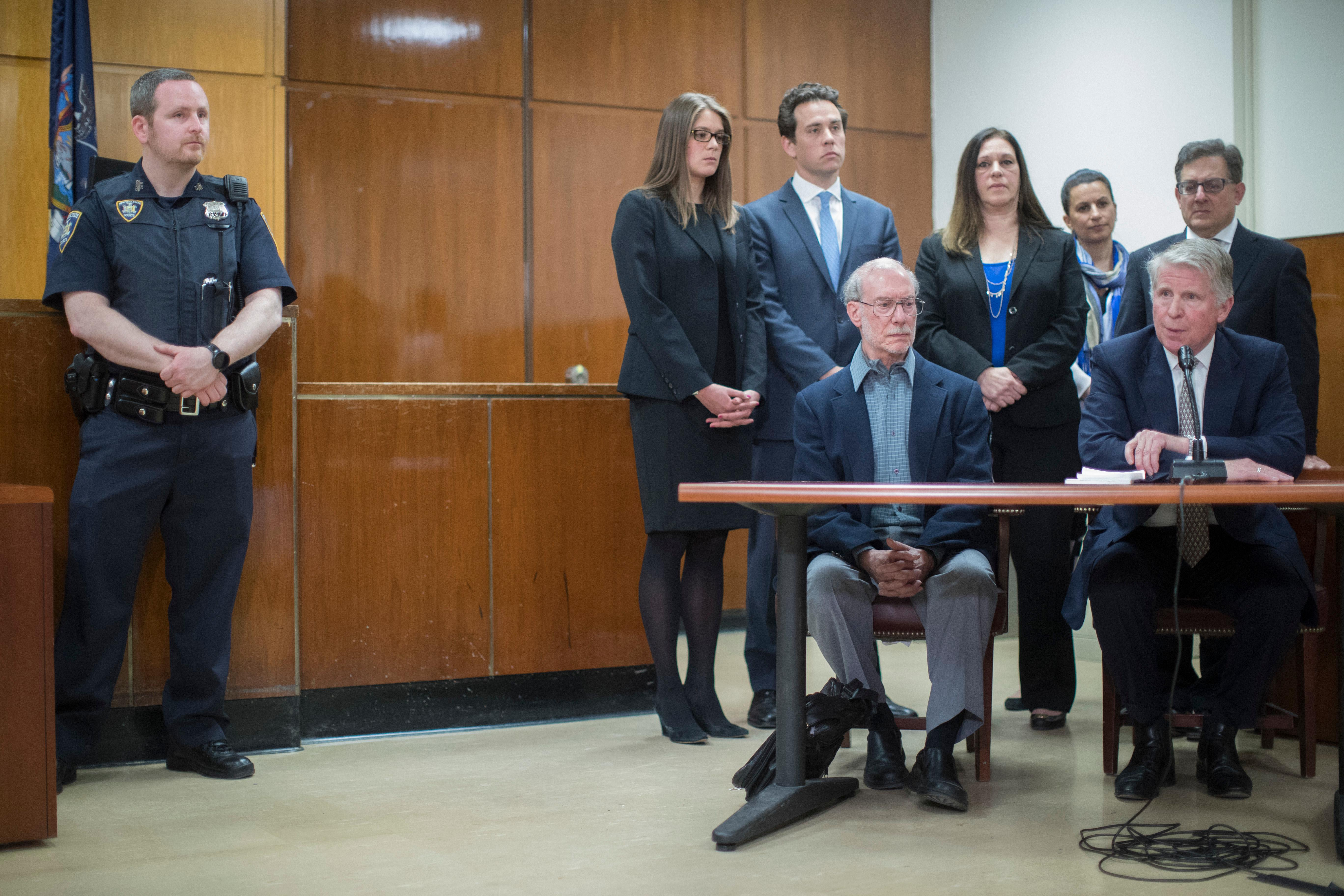 Stan Patz, foreground left, father of 6-year-old Etan Patz, is joined by Manhattan District Attorney Cy Vance, foreground right, Assistant District Attorney Joel Seidemann, background right, and Assistant District Attorney Joan Illuzzi-Orbon, second from right , background, as they speak to reporters after Pedro Hernandez, the man convicted of killing 6-year-old Etan Patz, one of America's most notorious missing-child cases, was sentenced at Manhattan Supreme Court, in New York, Tuesday, April 18, 2017. (AP Photo/Mary Altaffer)