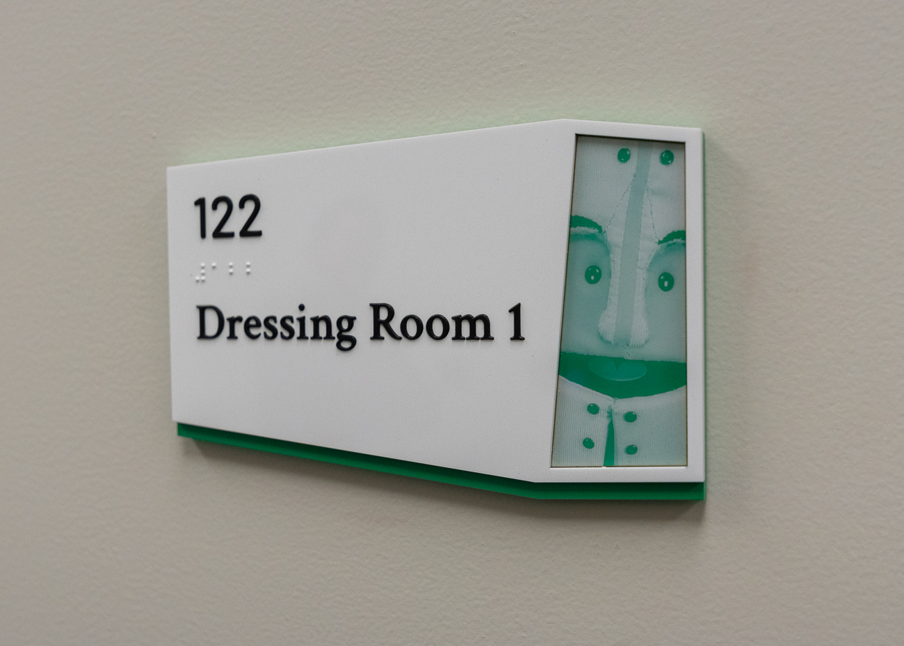 An image of the previous slide's puppet is used in the graphic for a room label. All rooms in the Madcap Education Center feature different puppets on their labels. / Image: Phil Armstrong, Cincinnati Refined // Published: 1.26.19