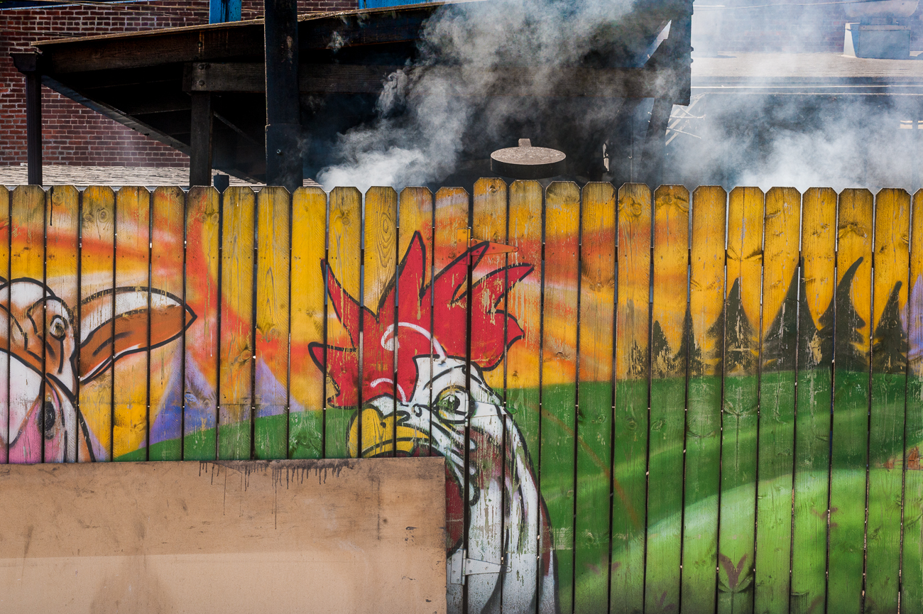 Mural on the fenced-in grill pit{ }/ Image: Kellie Coleman // Published: 6.19.20
