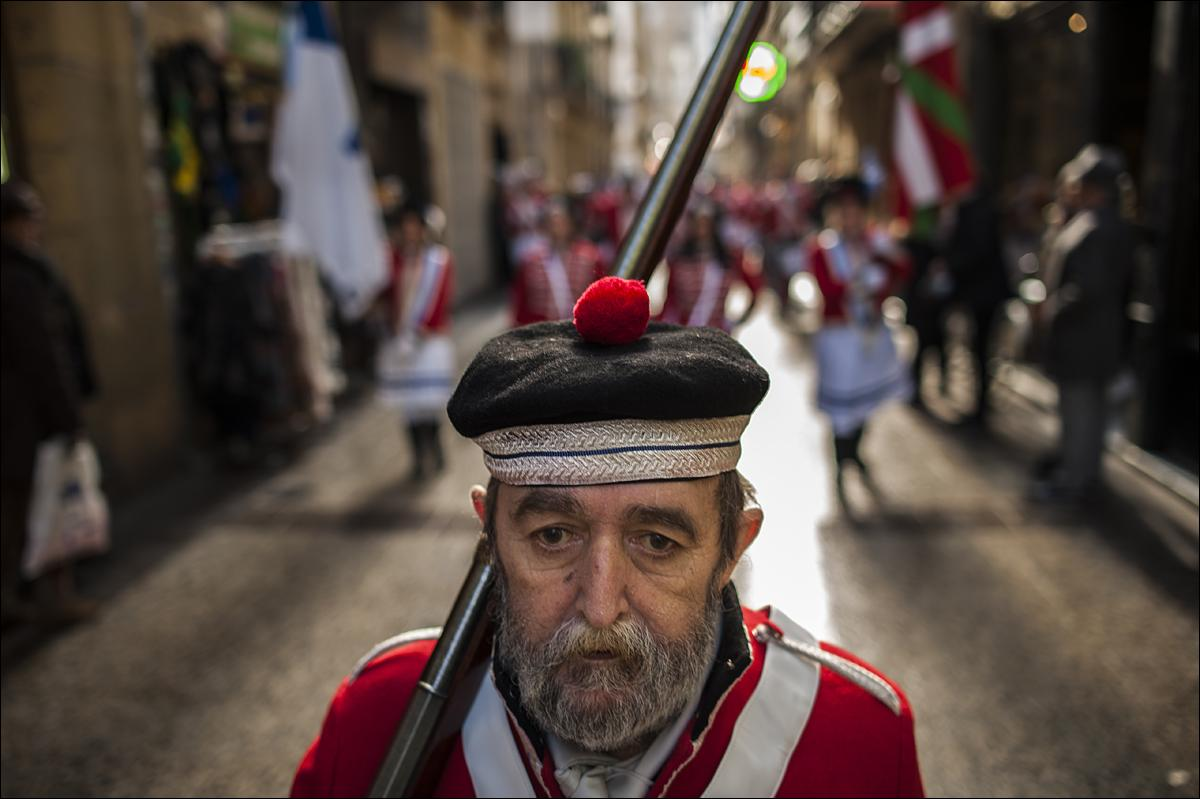 "An old ""Tamborillero'' wearing his uniform marchs in the traditional ""La Tamborrada'' the big day or ""El Dia Grande"", the main day of San Sebastian feasts, in the Basque city of San Sebastian, northern Spain, Wednesday Jan. 20, 2016. From midnight to midnight companies of perfectly uniformed marchers parade through the streets of San Sebastian playing drums and barrels in honor of their patron saint. (AP Photo/Alvaro Barrientos)"