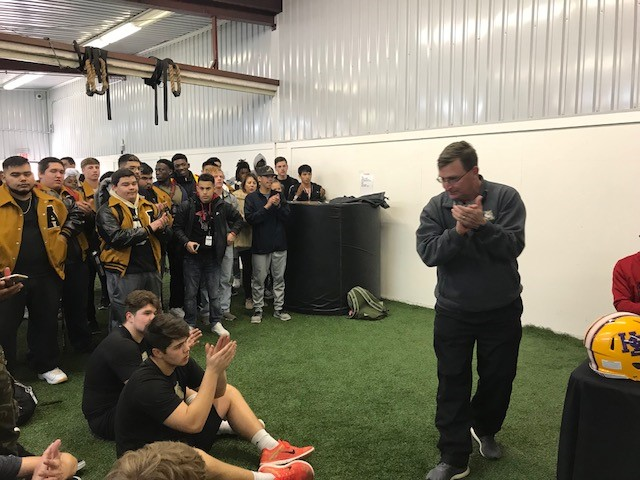 Abilene High Athletic Director Del Van Cox and members of the football team congratulated this years signing class.<p></p>