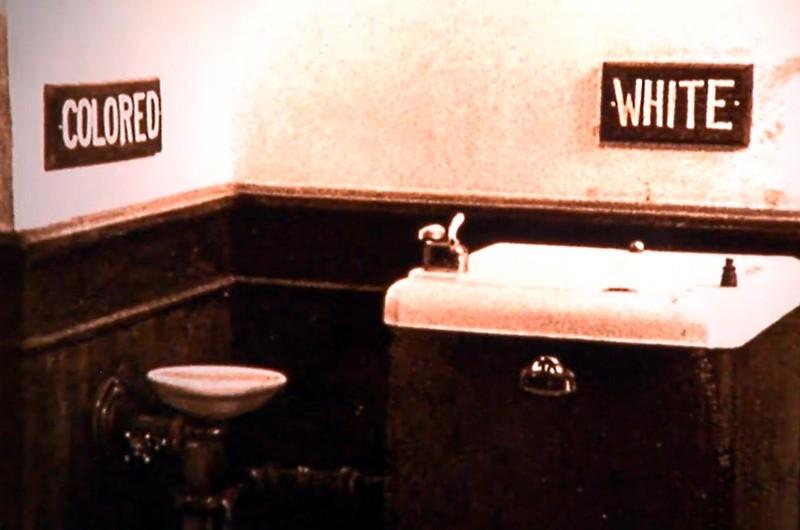"Screenshot of the segregated water fountains shown in the HBO documentary ""4 Little Girls."""