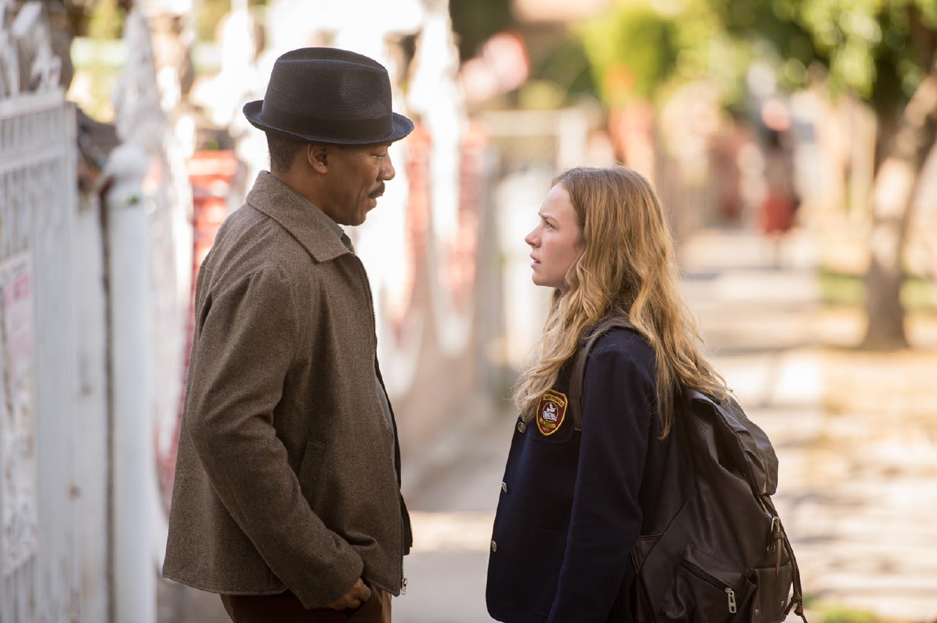 Eddie Murphy as Mr. Church talks to Britt Robertson (Charlotte). Courtesy Cinelou Films.