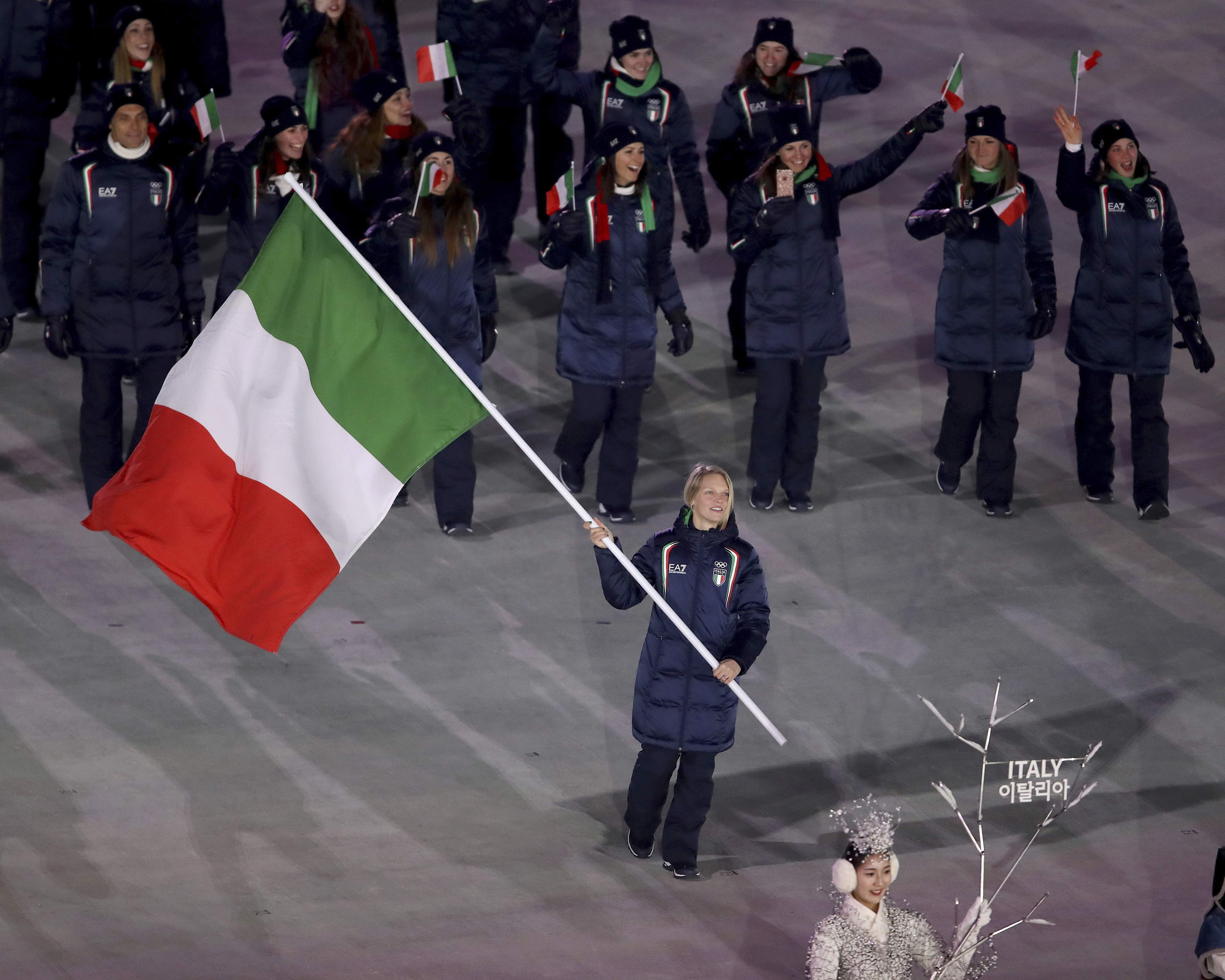 Arianna Fontana carries the flag of Italy during the opening ceremony of the 2018 Winter Olympics in Pyeongchang, South Korea, Friday, Feb. 9, 2018. (Sean Haffey/Pool Photo via AP)