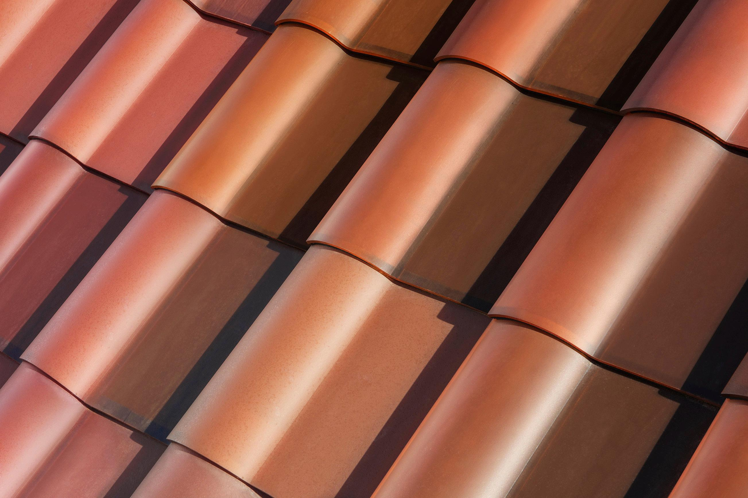 This photo provided by Tesla shows a detail of Tesla's new terracotta solar roof tiles. As of Wednesday, May 10, 2017, customers worldwide could order a solar roof on Tesla's website. The glass tiles are designed to look like a traditional roof, with options that replicate slate or terracotta tiles. The solar tiles contain photovoltaic cells that are invisible from the street. Installations will begin in June in the U.S., starting with California. Installations outside the U.S. will begin in 2018, the company said. (Courtesy of Tesla via AP)