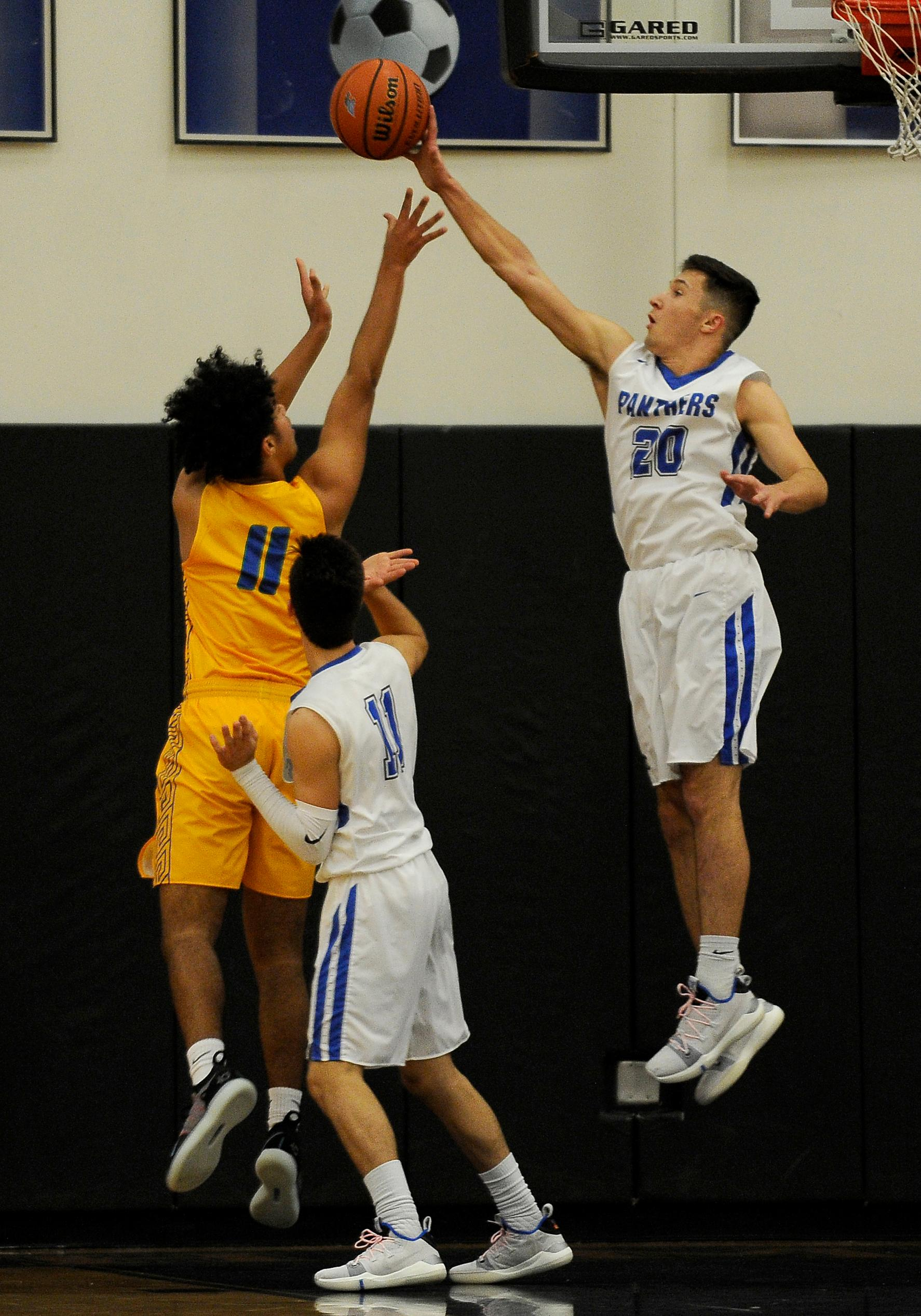 Andy Atkinson / Mail Tribune South's Gio Bottero blocks the shoot from Aloha's Timothy Davis during the 2nd quarter.
