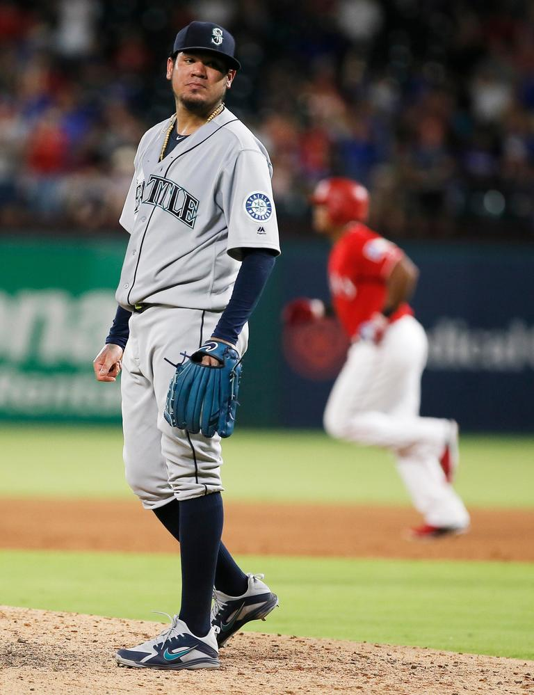 Seattle Mariners starting pitcher Felix Hernandez waits as Texas Rangers' Adrian Beltre rounds the bases after hitting a solo home run during the sixth inning of a baseball game Tuesday, Aug. 7, 2018, in Arlington, Texas. The Rangers won 11-4. (AP Photo/Brandon Wade)