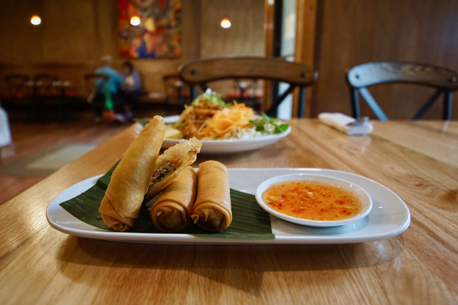 Crispy Spring Rolls: Deep fried pork rolls with crystal noodles, cabbage, and carrot served with garlic chili sauce / Image: Brian Planalp // Published: 9.15.17