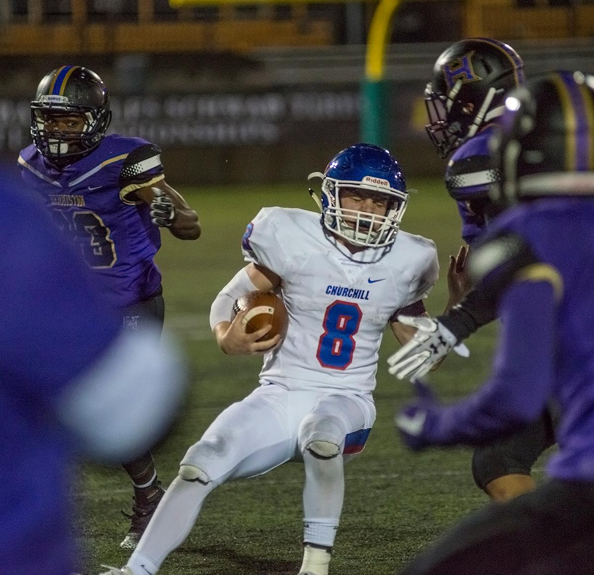 Churchill Lancers running back Dalton McDaniel (#8) is surrounded by Hermiston Bulldogs defense during a play.The Hermiston Bulldogs defeated the Churchill Lancers 38-35 for the 5A state title Saturday evening at Hillsboro Stadium. Photo by Abigail Winn, Oregon News Lab
