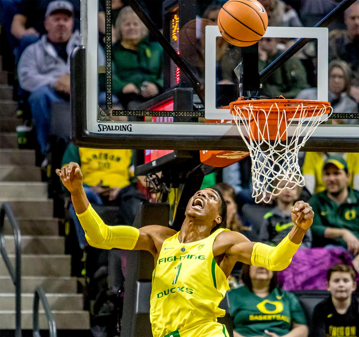 The Duck's Kenny Wooten (#1) watches the ball go up and into the basket as he defends. The Oregon Ducks defeated the Colorado Buffaloes 77-62 at Matthew Knight Arena on Sunday. Troy Brown had a season-high score of 21 points, Elijah Brown added 17, while Kenny Wooten and Payton Pritchard added 13 and 12 respectively. Oregon is now 1-1 in conference play. The Ducks next face off against the Oregon State Beavers in Corvallis on Friday, January 5th. Photo by August Frank, Oregon News Lab