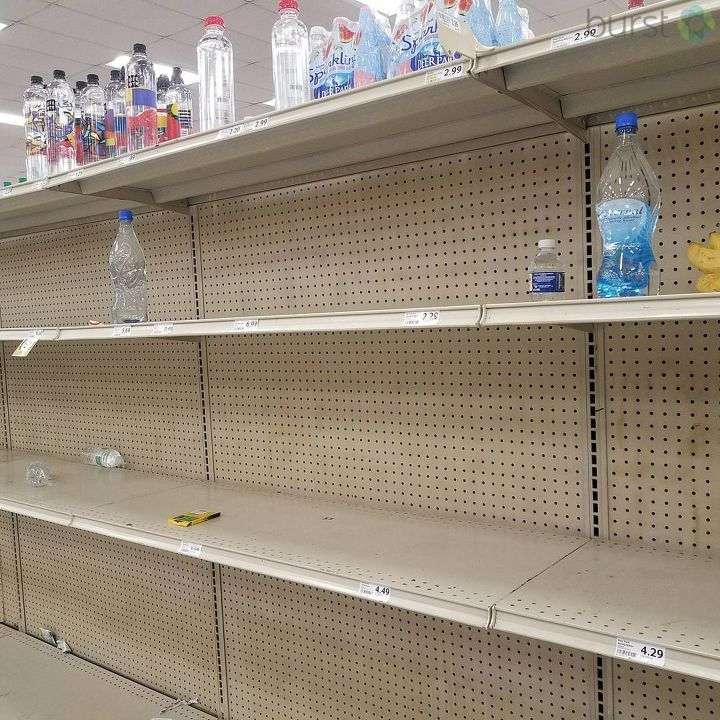 "Store shelves in Pensacola, FL are empty in preparation for the storm as user LaQuetta H. Glaze said: ""Local store shelves......Wow. For the locals: This is Winn Dixie on 9 Mile and Publix on 9 Mile and Pine Forest."" (Photo submitted by LaQuetta H. Glaze/Burst)"