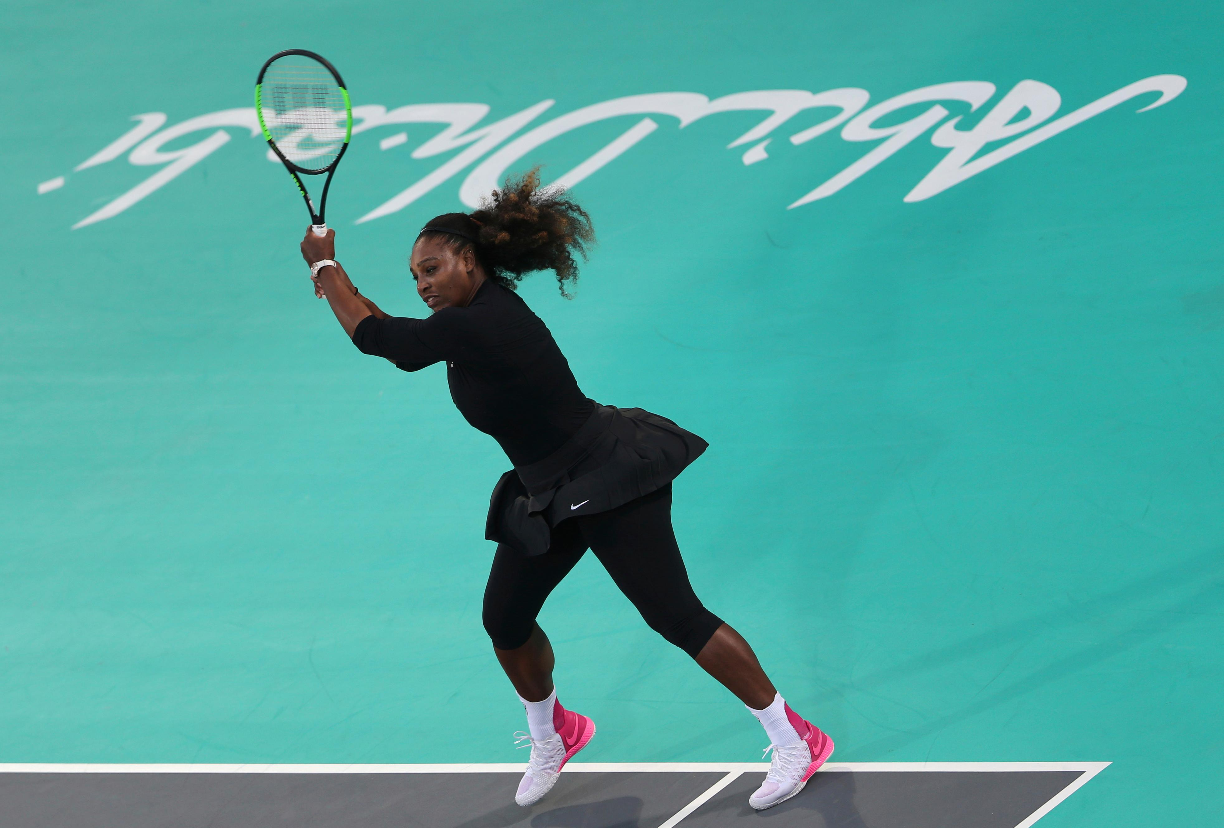 Serena Williams from the U.S. returns the ball to Jelena Ostapenko of Latvia during the final day of the Mubadala World Tennis Championship in Abu Dhabi, United Arab Emirates, Saturday, Dec. 30, 2017. (AP Photo/Kamran Jebreili)