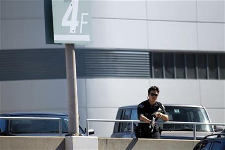 Police stand guard outside Los Angeles International Airport on Friday, Nov. 1, 2013. A gunman armed with a semi-automatic rifle opened fire at the airport on Friday.