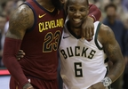 Cleveland Cavaliers' LeBron James talks to Milwaukee Bucks' Eric Bledsoe after the second half of a game Tuesday, Dec. 19, 2017, in Milwaukee.