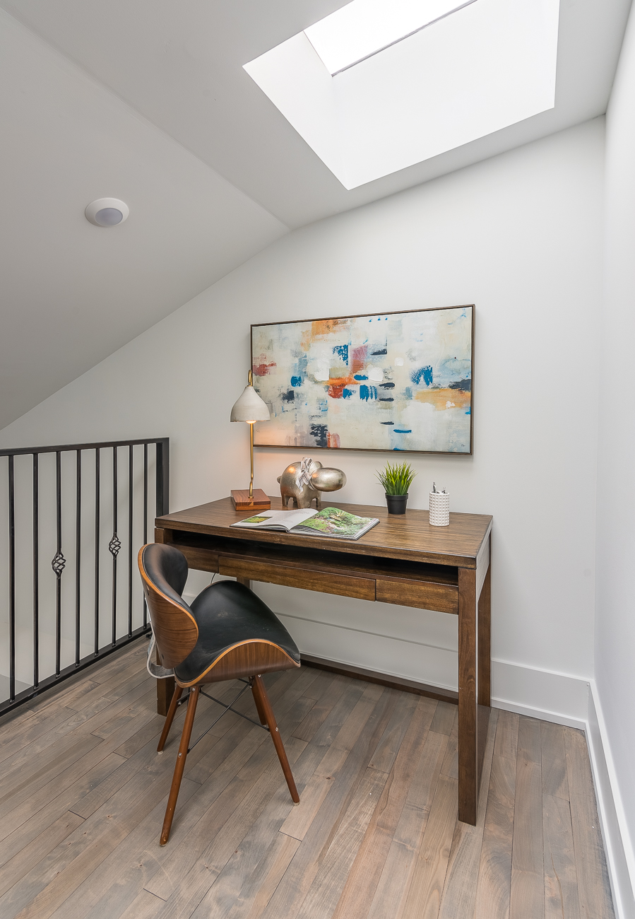 A loft area at the top of the main staircase provides an excellent space for a desk that sits directly beneath a skylight. / Image: Phil Armstrong, Cincinnati Refined // Published: 2.4.19