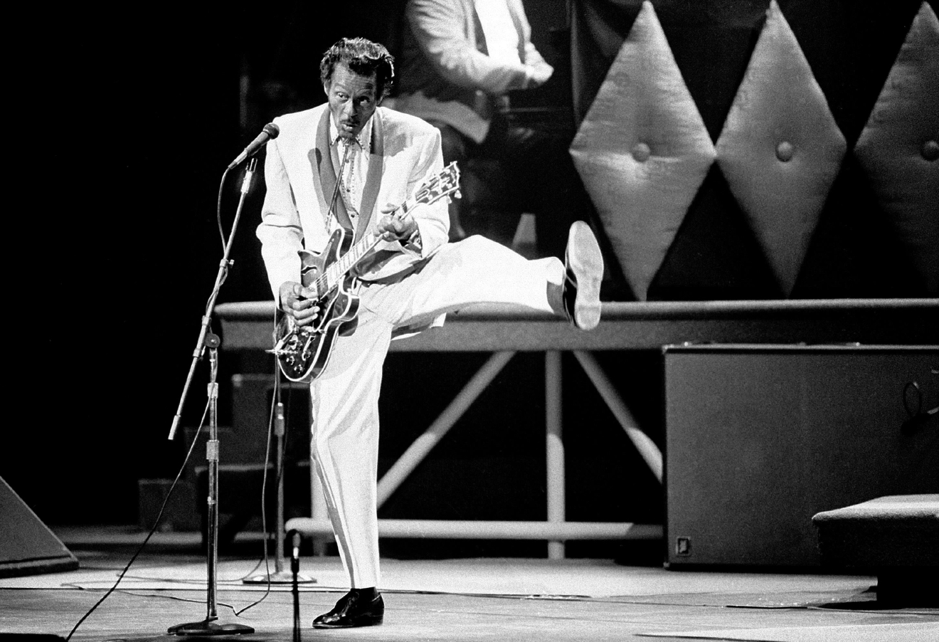 "Chuck Berry performs during a concert celebration for his 60th birthday at the Fox Theatre in St. Louis, Mo., Oct. 17, 1986.  The concert is being filmed for a motion picture documentary titled ""Chuck Berry Hail! Hail! Rock 'n' Roll.""  (AP Photo/James A. Finley)"