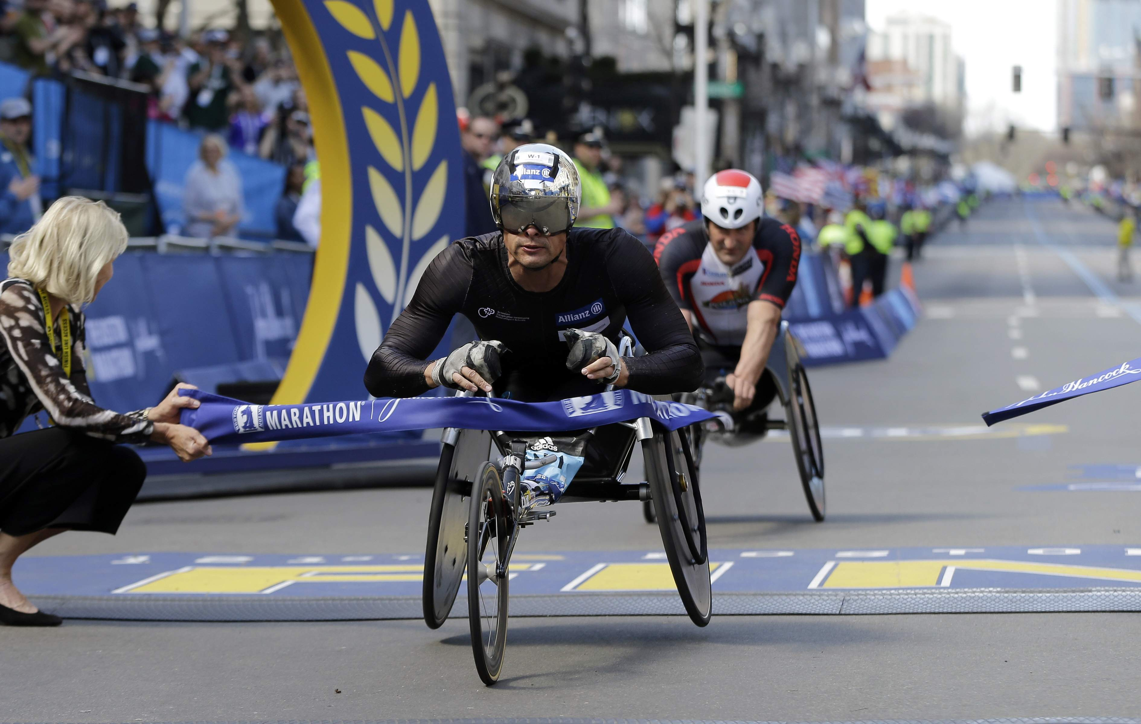 Marcel Hug, of Switzerland, wins the men's wheelchair division ahead of Ernst Van Dyk, right, of South Africa, in the 121st Boston Marathon on Monday, April 17, 2017, in Boston. THE ASSOCIATED PRESS