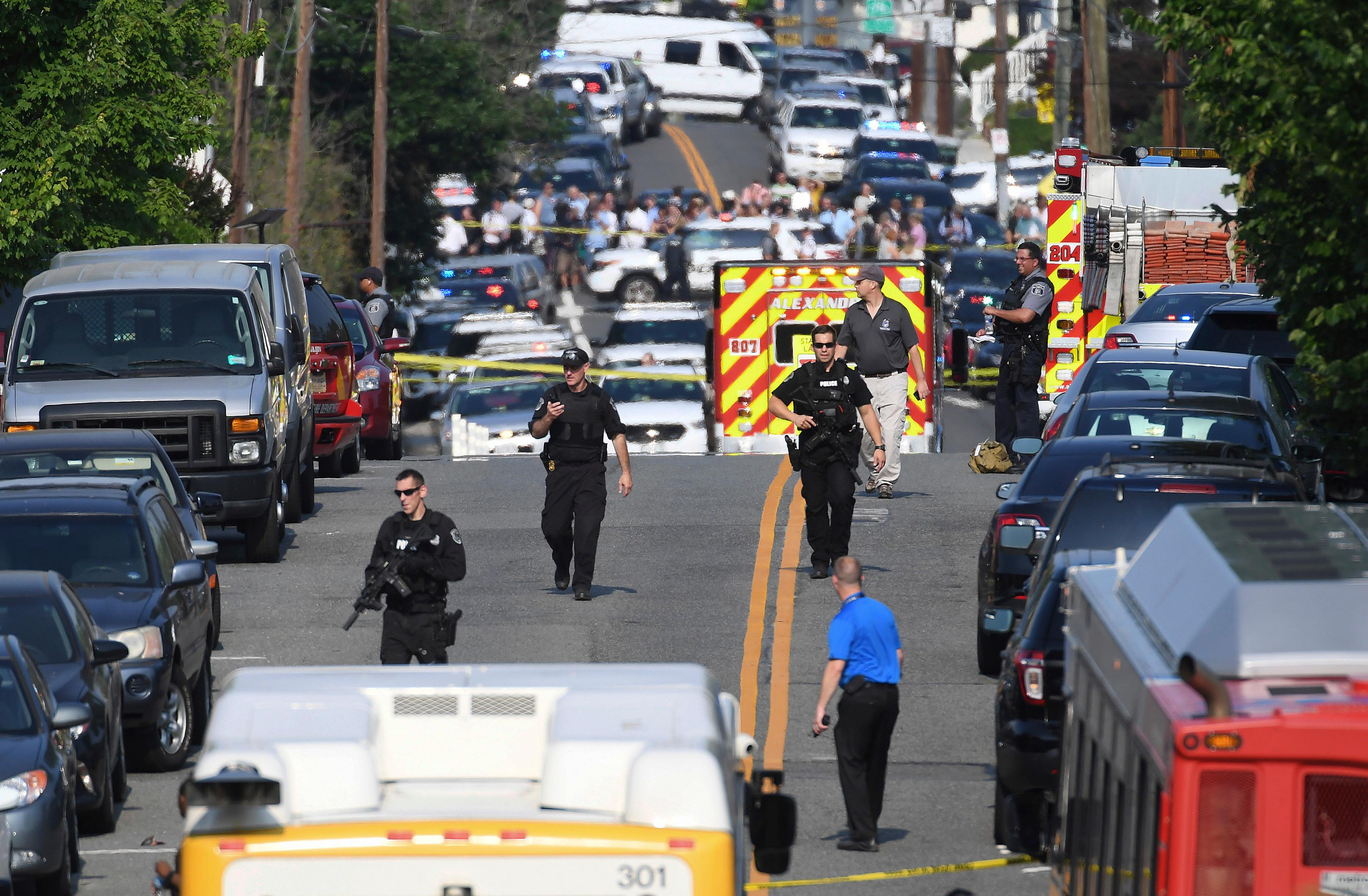 Emergency personnel respond after reports of shots fired Wednesday June 14, 2017 in Alexandria, Va.   A top House Republican, Steve Scalise of Louisiana, was shot by a rifle-wielding gunman early Wednesday at a congressional baseball practice just outside of Washington. Several other people were also wounded, officials said.  (Matt McClain/The Washington Post via AP)