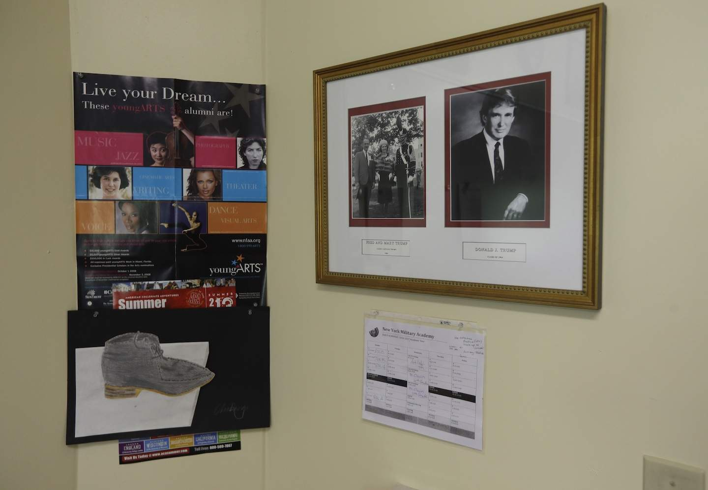 In this Thursday, Sept. 8, 2016 photo, photos of Donald Trump, right, and Trump with his parents, hang on a classroom wall at the New York Military Academy, in Cornwall-on-Hudson, N.Y. Trump talks tough about dealing with China, but his alma mater is looking to Asia to survive. The school has reopened after a rough patch with new Chinese owners and a new superintendent who emigrated from China before making her mark in the New York City school system. (AP Photo/Mike Groll)