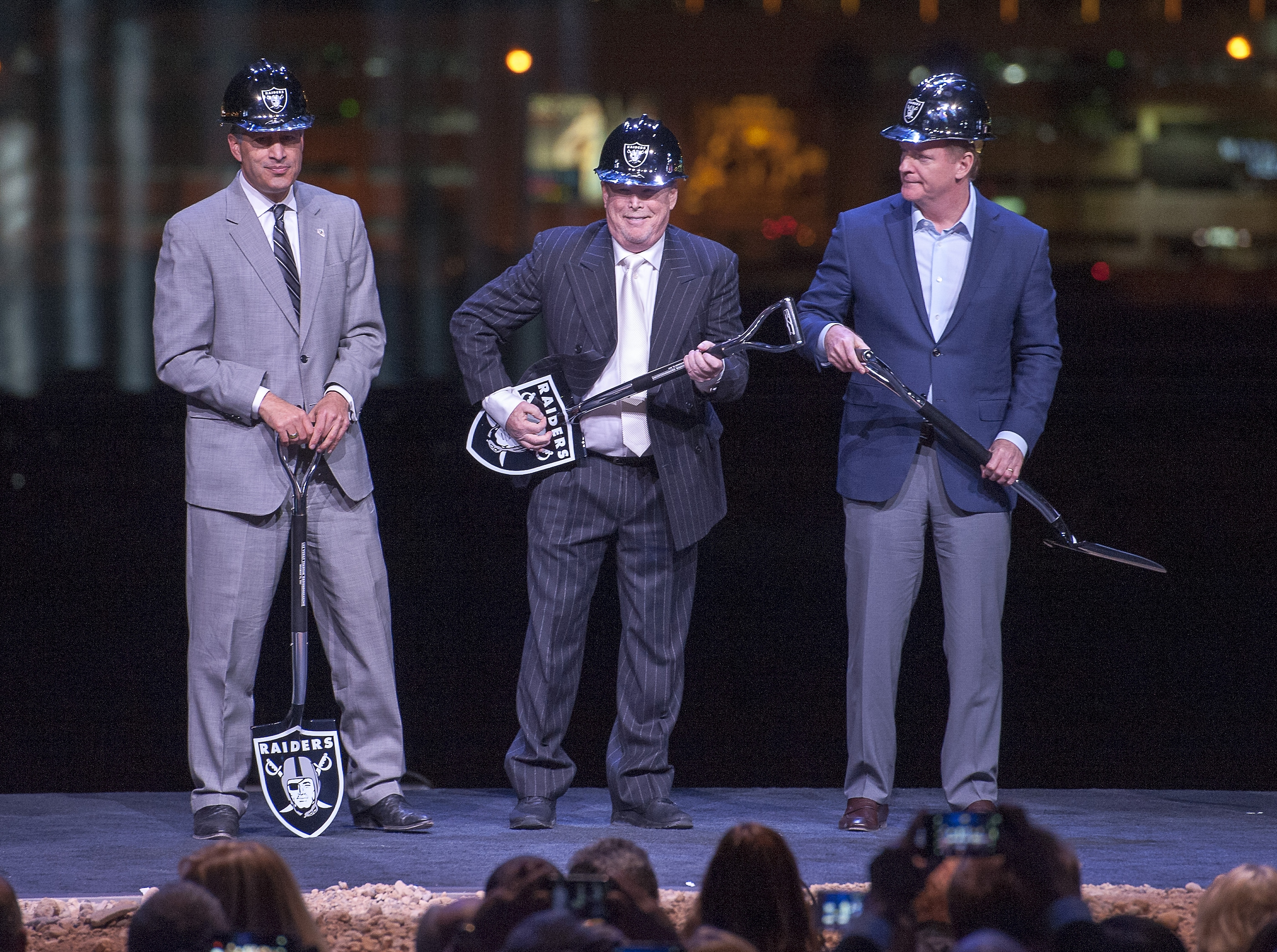 Oakland Raiders owner Mark Davis, center, clowns with his shovel along with Nevada Governor Brian Sandoval, left, and NFL Commissioner Roger Goodell as they prepare to turn the first earth at the groundbreaking ceremony for the Raiders Las Vegas Stadium at the Polaris Avenue site in Las Vegas on Monday, Nov. 13, 2017. CREDIT: Mark Damon/Las Vegas News Bureau